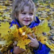 Joyful kid with leaves — Photo
