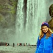 Young woman at the waterfall in Iceland — Stock Photo