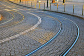 Winding road with tram lines — Stock Photo