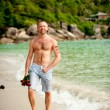 Man on the beach — Stock Photo