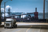 Heavy truck running from industrial plant — Stock Photo