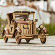 Old vintage retro style handcrafted wooden car model — Stock Photo