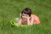 Little happy smiling girl talking on the cellphone — Stock Photo
