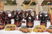 Close-up view of wooden colorful handmade human skulls on white table — Stock Photo