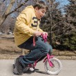Big funny teenage boy riding small bike — Stock Photo
