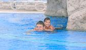 Two happy children enjoying swimming time in the pool — Foto de Stock