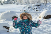 Joyfull little girl in winter park on sunny beautifull fresh day — Stok fotoğraf