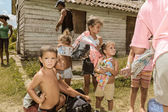 Local Cuban village people and kids holding a cloth and goods — Stock Photo