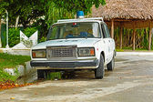 Old Lada police patrol car at Cuban Cayo Coco island resort — ストック写真