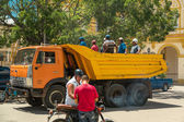 Workers were delivered by a dump-truck to the job site — Foto de Stock