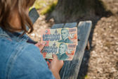 Child holding  fake decorative money banknotes — Stock Photo