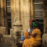 Retro style looking women enjoying cigar on old Havana street — Stock Photo #42754755