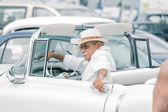 Wealthy man getting out from his luxury car on old Havana street — Stock Photo