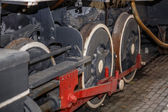 Fragment of old style technology steam train wheels and parts — Stock Photo