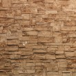 Fragment of detailed brick textured stone wall background — Stock Photo