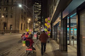Husband and wife in motorized car promenade on Toronto downtown night streets and celebrate her birthday — Stok fotoğraf