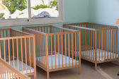 Baby room  with wooden beds — Photo
