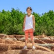 Little joyful smiling girl standing against Cheltenham Badlands background on sunny warm day — Stock Photo