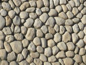Stone wall of natural stones small — Stock Photo