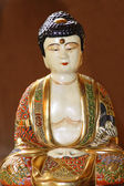 Old porcelains buddha figurine — Stock Photo