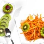 Salad with kiwi and carrots — Stock Photo #40728391