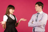 Man and woman in business attire talking — Stock Photo