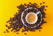 Cup coffee yellow background — Stock Photo