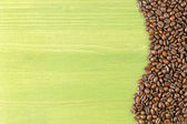 Coffee beans green table — Stock Photo
