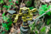 Metal automatic water sprinkler — Stock fotografie