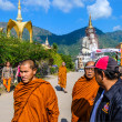 Monks walking on street under blue sky in Phetchabun — Stock Photo #40861409