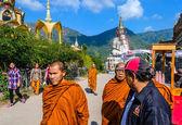 Monks walking on street under blue sky in Phetchabun — Stock fotografie