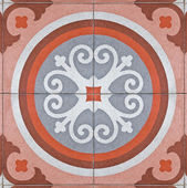 Pattern on ancient square tiles — Stock Photo