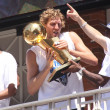 Dirk Nowitzki of the Dallas Mavericks NBA team carrying the NBA cup during the champions parade in Dallas Texas - Stock Photo