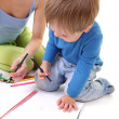 Mother teaches his son to draw — Foto Stock