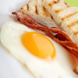 Breakfast - toasts, eggs, bacon — Stock Photo