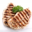 Постер, плакат: Grilled chicken breasts on a plate with fresh vegetables