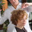 Woman at hairdresser. — Stockfoto
