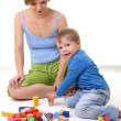 Stock Photo: Mother playing with son