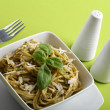 Italian pasta with pesto sauce and parmesan. - Stock Photo