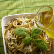 Italian pasta with pesto sauce and parmesan. — Stock Photo