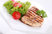 Grilled chicken breasts on a plate with fresh vegetables — Stock Photo
