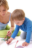 Mother teaches his son to draw — Stock Photo