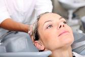 Washing hair in salon — Stock Photo