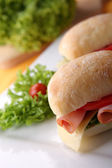 Sandwich with fresh vegetables, ham and cheese — Stock Photo