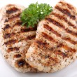 Grilled chicken breasts on a plate with fresh vegetables — Stock Photo #25891735