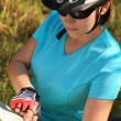 Stock Photo: Summer theme. Woman on bicycle reading a map.