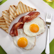 Breakfast - toasts, eggs, bacon — Stock Photo #25899435
