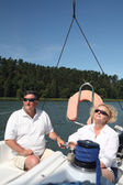 Middle-aged couple on boat sailing — Stock Photo