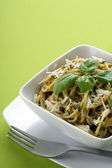 Italian pasta with pesto sause, parmesan and olive oil. — Stock Photo