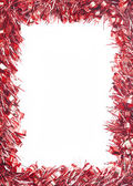 Red Christmas tinsel garland — Stock Photo
